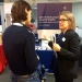 Helene Komlos Grill, Project Manager for International Communications, speaks to a visitor to the University's booth at the QS educational fair.