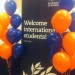 Balloons and roll-up saying ''Welcome International Students''!