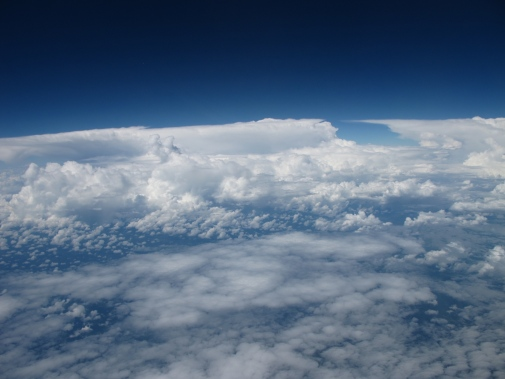 Photograph: Radovan Krejci, co-author of the study. On this picture, thin mid-level clouds are observed in the foreground with deep convective clouds in the background.