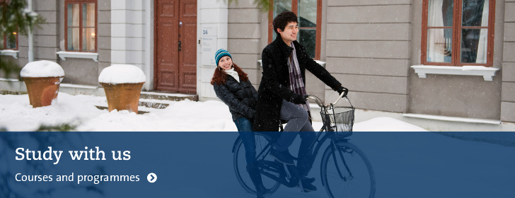 Students on a bike in snow.
