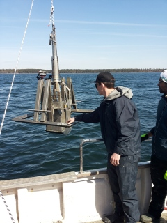 "Researchers from Stockholm University collecting intact parts of the Baltic Sea floor for investigations of greenhouse gases. The instrument is called ""boxcorer"". Photo: Alessandra Vicenzi."