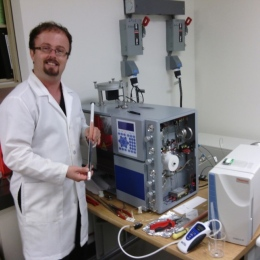 Dr. Huffer fixing a mass-spectrometer, Smithsonian Museum Conservation Institute, 2015