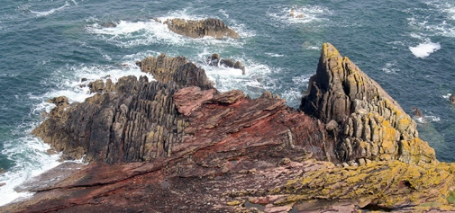 Siccar Point in Scotland, where James Hutton found an angular unconformity in 1788. At this classic locality, 345 million year old Devonian red sandstone lies on top of 425 year old Silurian rock. He regarded this as evidence for a uniformitarian theory of geological development (the present is the key to the past).
