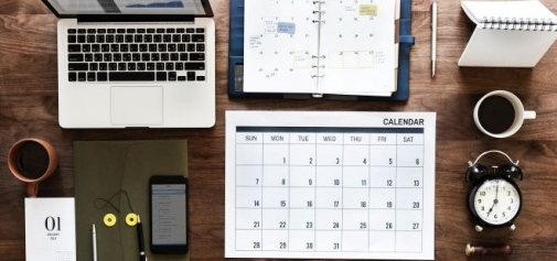 Desk with computer, phone and calendar