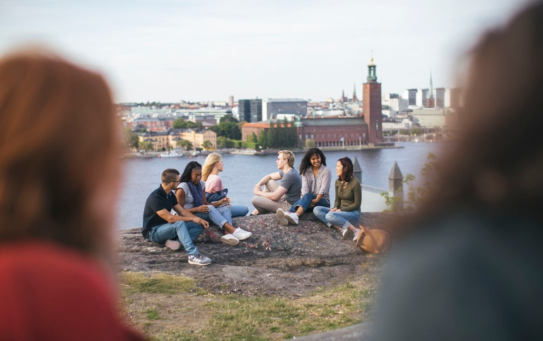 Students in Stockholm with City hall in background