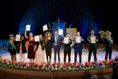 Newly graduated on the stage of Aula Magna