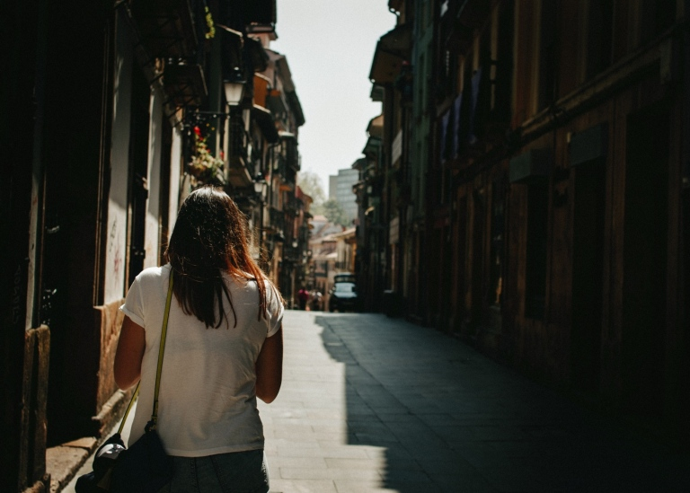 Person walking in a Spanish village Photo: Hector Martinez/Unsplash