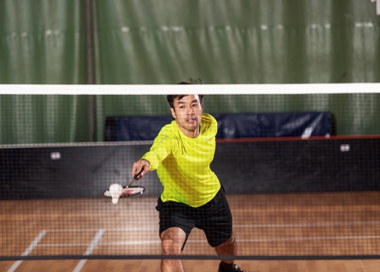 A student playing badminton. Photo: Frescati Sports Center