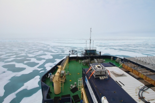 The foredeck of the icebreaker Oden with the atmospheric measurement tower, moving through sea ice w