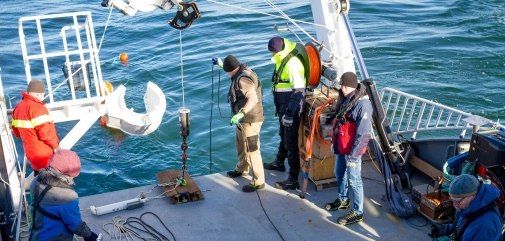 Researchers deploying instruments from R/V Electra for long-term measurements in the water.