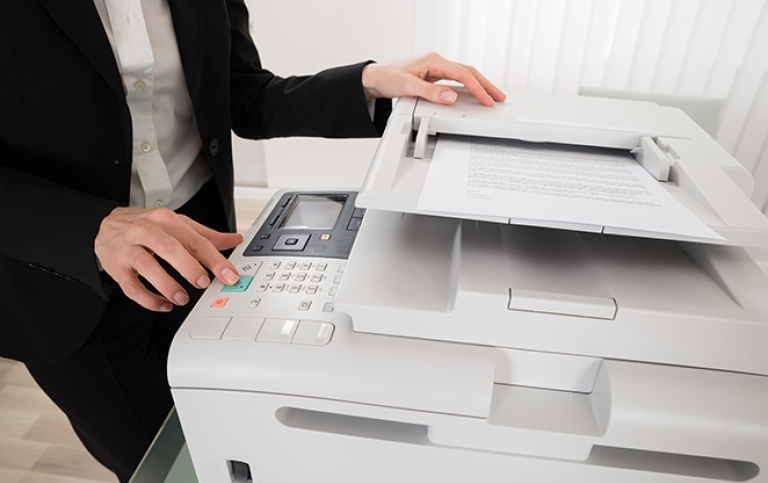 Woman pressing printers button