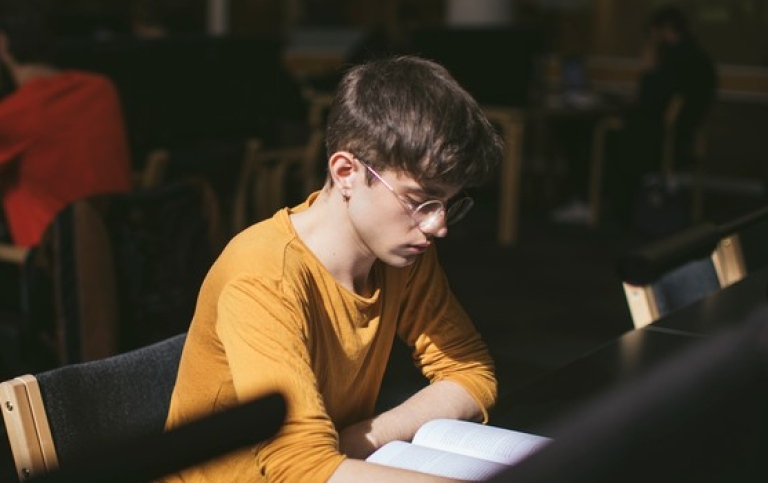 A student studying in the library. Photo: Niklas Björling
