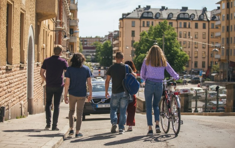A group of students with a bike in central Stockholm. Photo: Niklas Björling