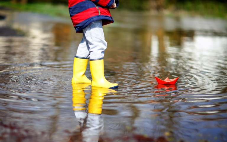 34360392-happy-little-kid-boy-in-yellow-rain-boots-playing-with. Mostphotos_Irina Schmidt.jpg