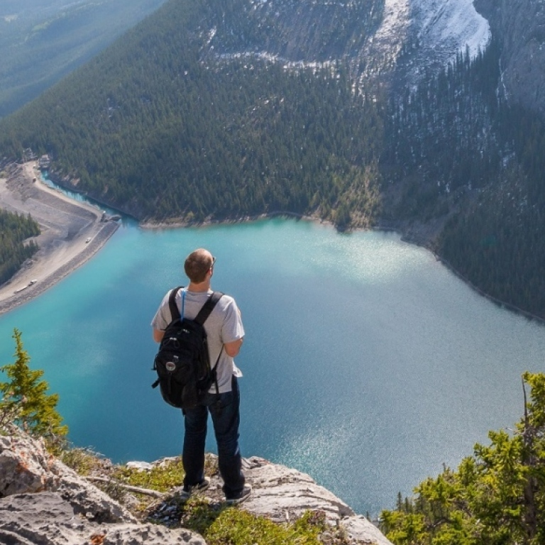 A person looking at stunning mountain view. Photo: Kalen Emsley/Unsplash