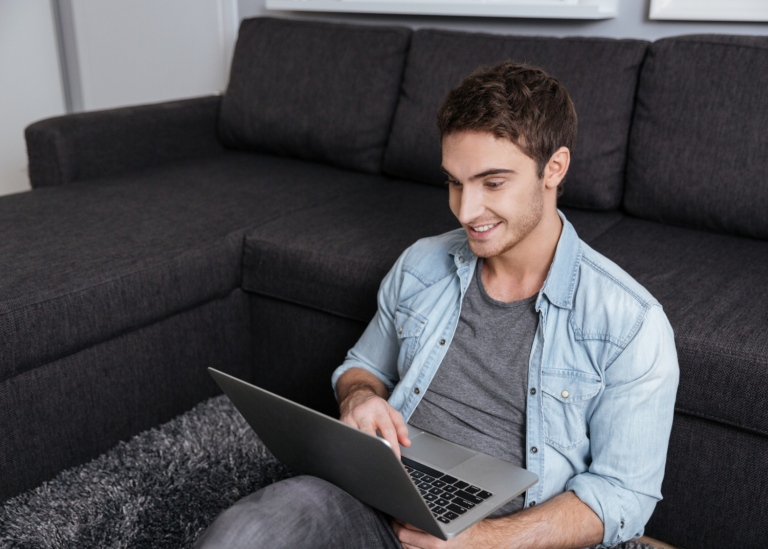 Guy with a laptop at home. Photo: Mostphotos