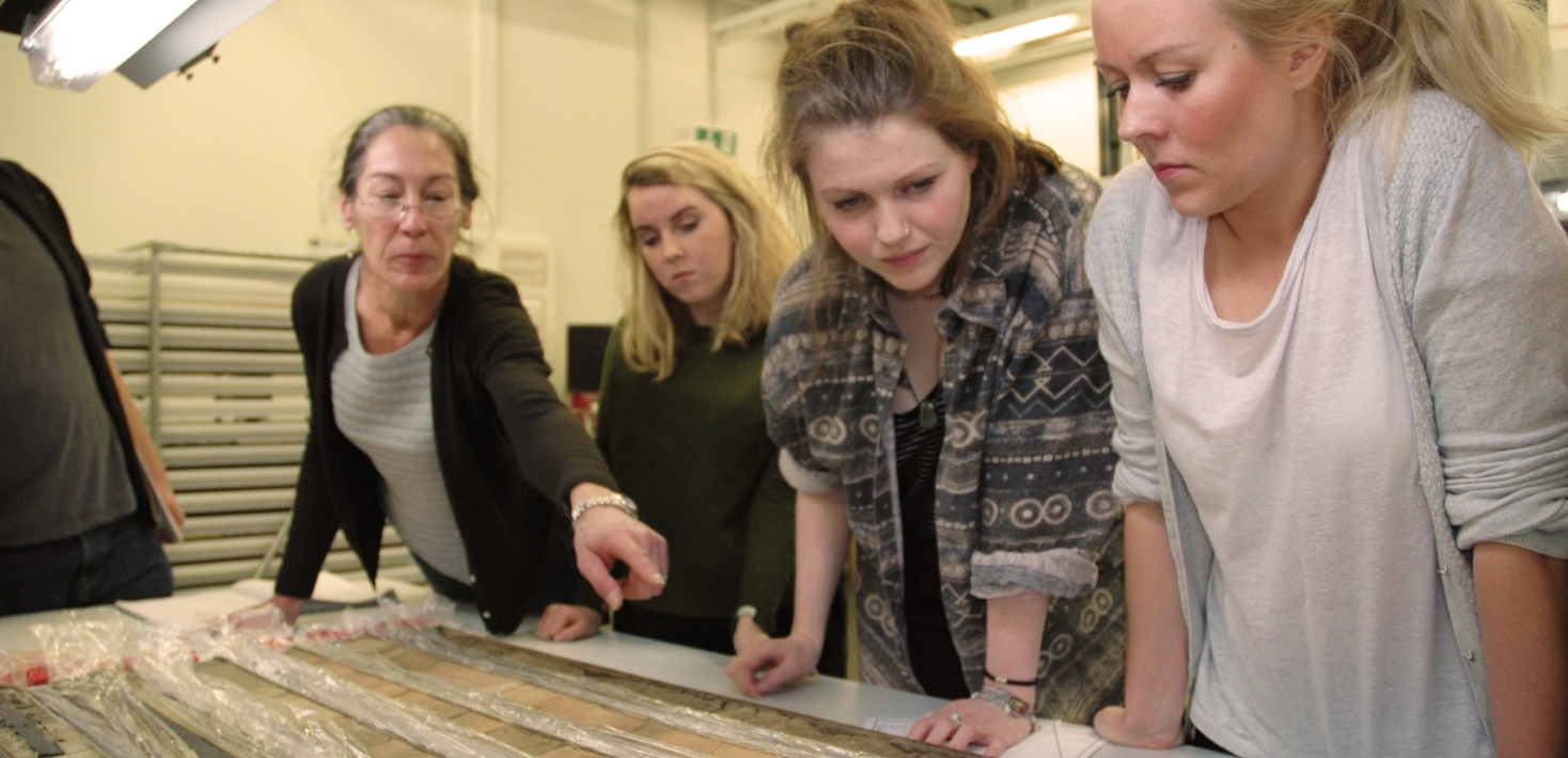 Students looking at sediment cores.