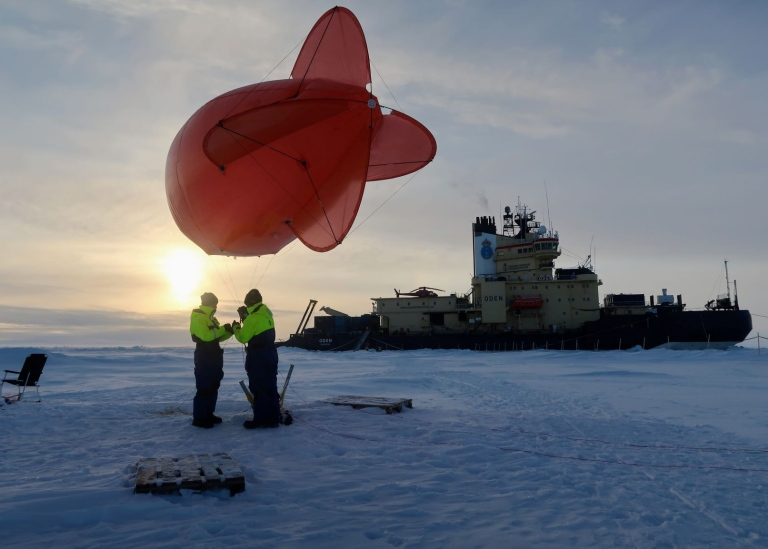 Scientists working on the ice in the North Pole during expedition Arctic Ocean 2018. Credit: Paul Zi