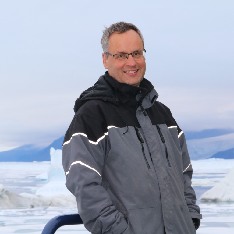 Volker on Oden, with an arctic view in the background