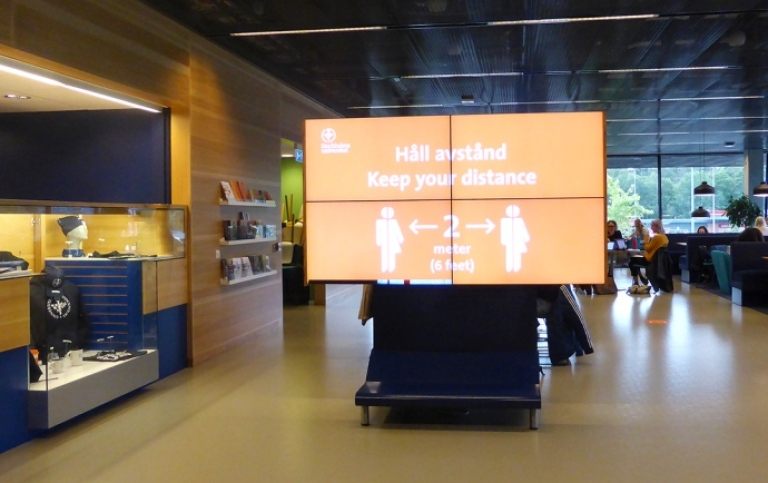 view of a big screen with information about Covid-19