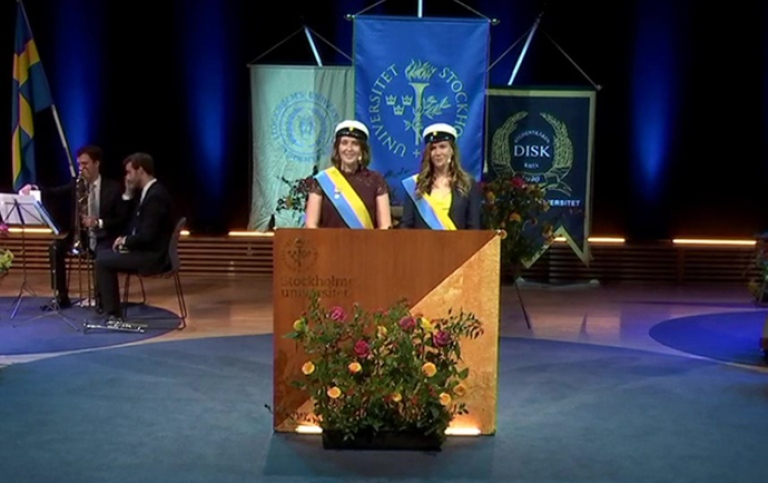 Two student marshals in Aula Magna