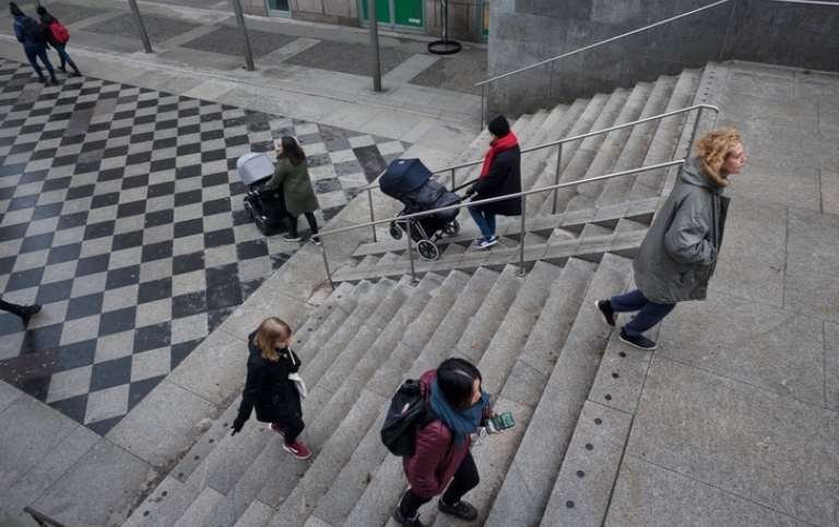 People walking up and down the stairs outdoors.
